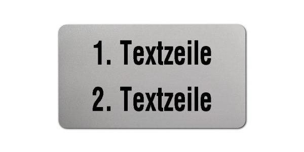 """Produktbild:Universaletiketten Material:Folie silber Größe:45x25mm Kopfzeile:""""Ihr Wunschtext"""" Barcode:ohne Stellenanzahl:ohne Ausführung:1 Etikett pro Nummer Etiketten je Rolle:1000"""